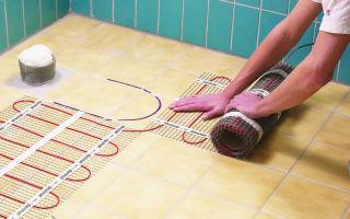 Как сделать тёплый пол в ванной: виды и монтаж
